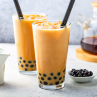 Two glasses of Bubble Tea in clear glass cups.