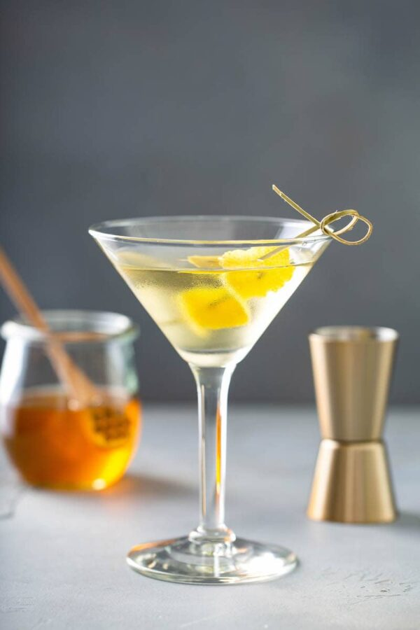 Martini with lemon and honey inside glass