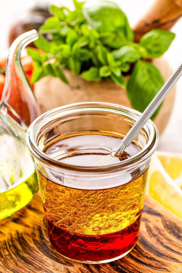 Olive Oil and vinegar for Greek Salad Dressing in a jar.