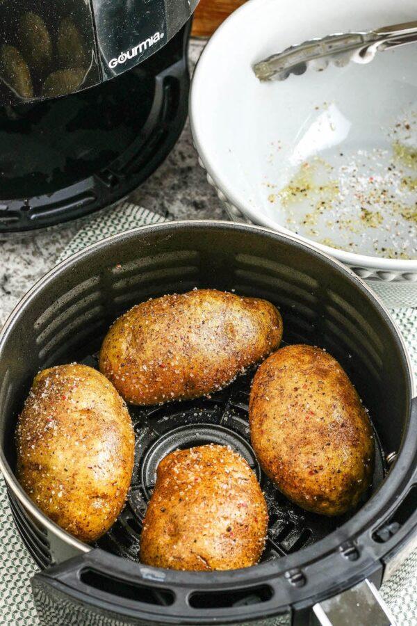 Baked Potatoes in Air Fryer basket.