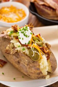Baked Potato in air fryer filled with toppings.
