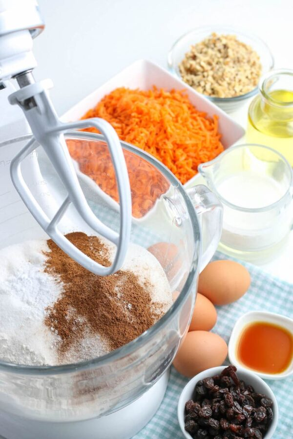 Ingredients for carrot cake cupcakes in stand mixer.