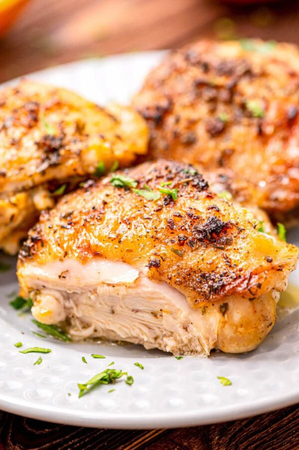 A baked chicken breasts, cut into to show doneness.