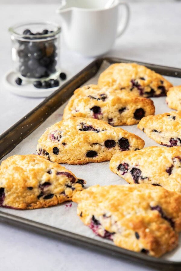 Blueberry scones fresh out of the oven on a baking sheet