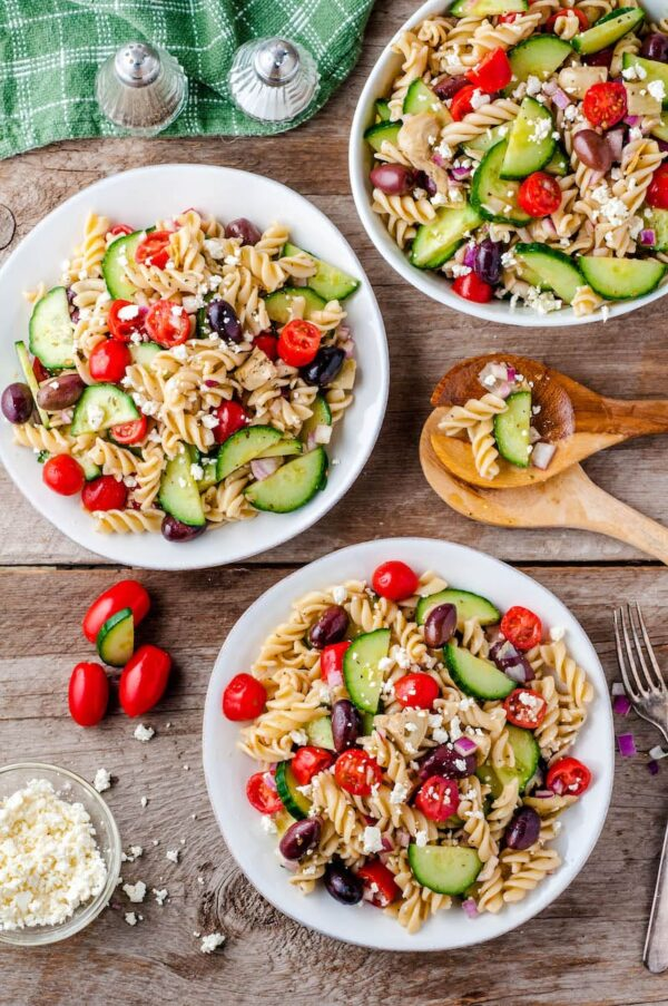 Three bowls of Greek pasta salad.