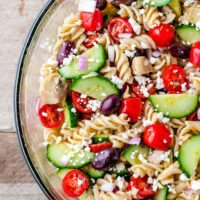 Greek pasta salad in a serving bowl.