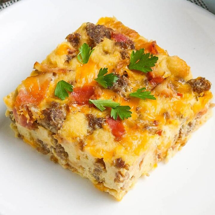 Overnight breakfast casserole served on a white plate.