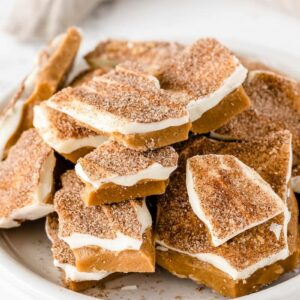 Cinnamon sugar toffee on a white plate with a napkin.