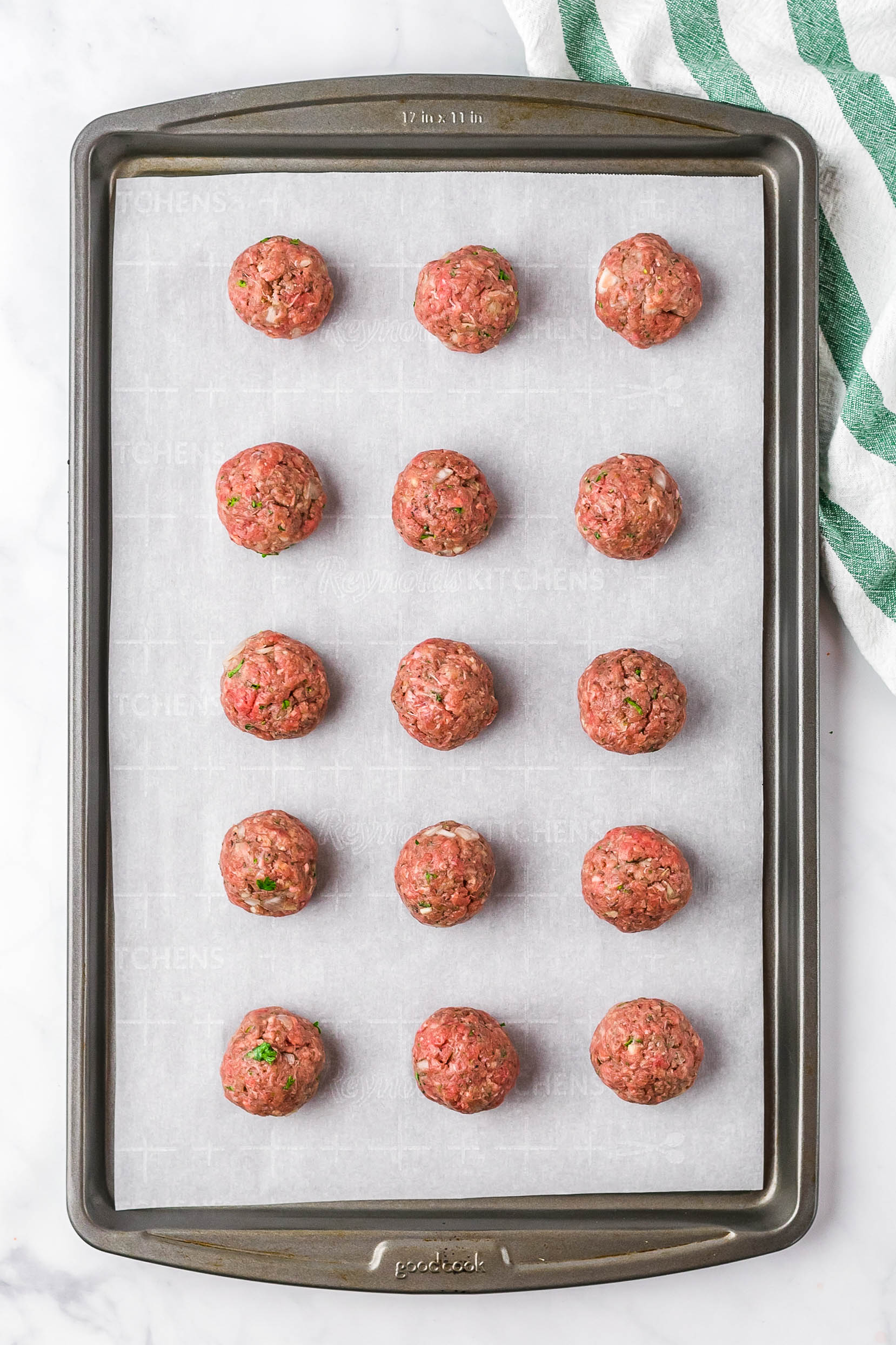 Uncooked Swedish Meatballs Assembled on a Baking Sheet