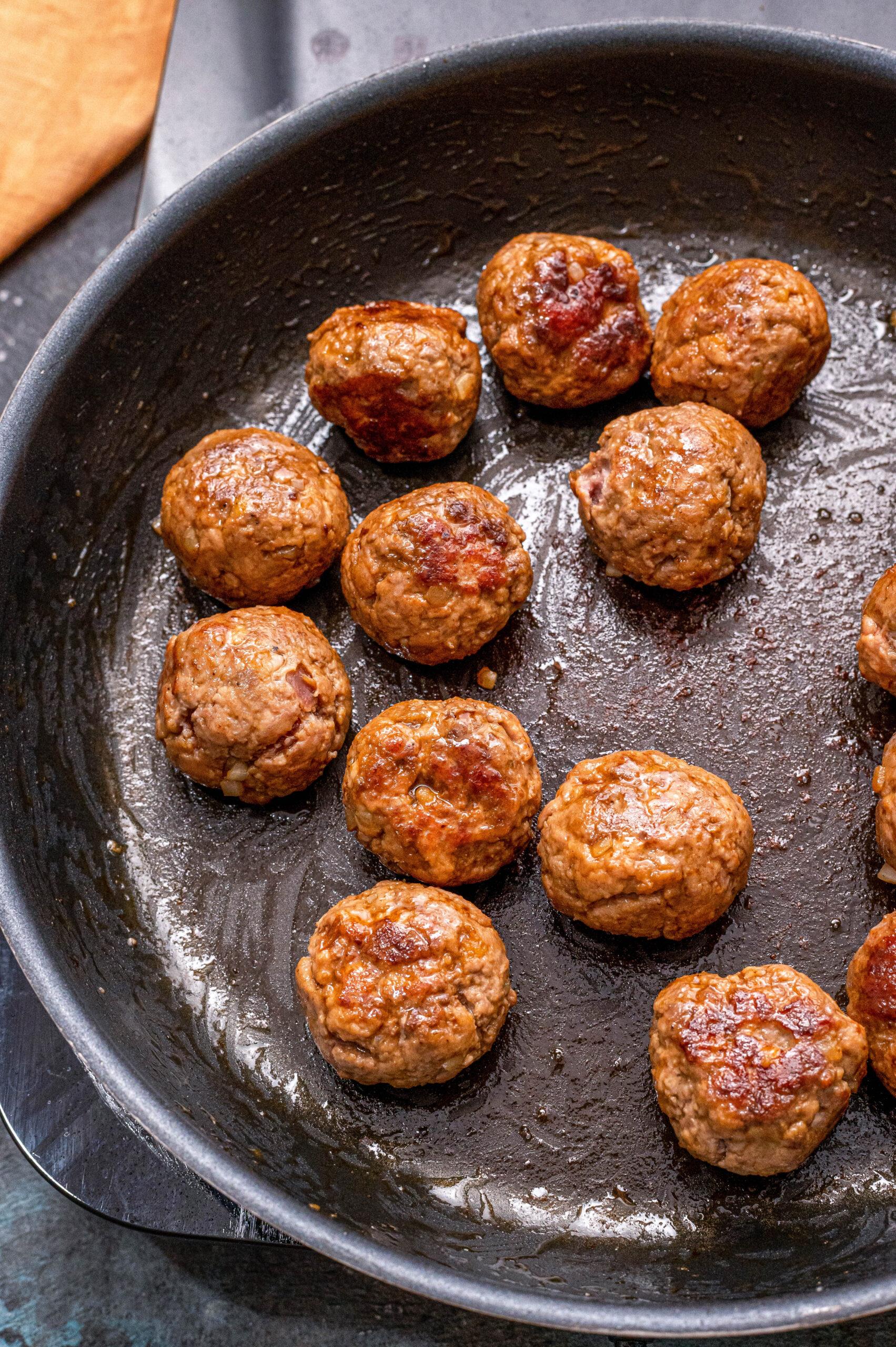 Swedish Meatballs Frying in a Skillet
