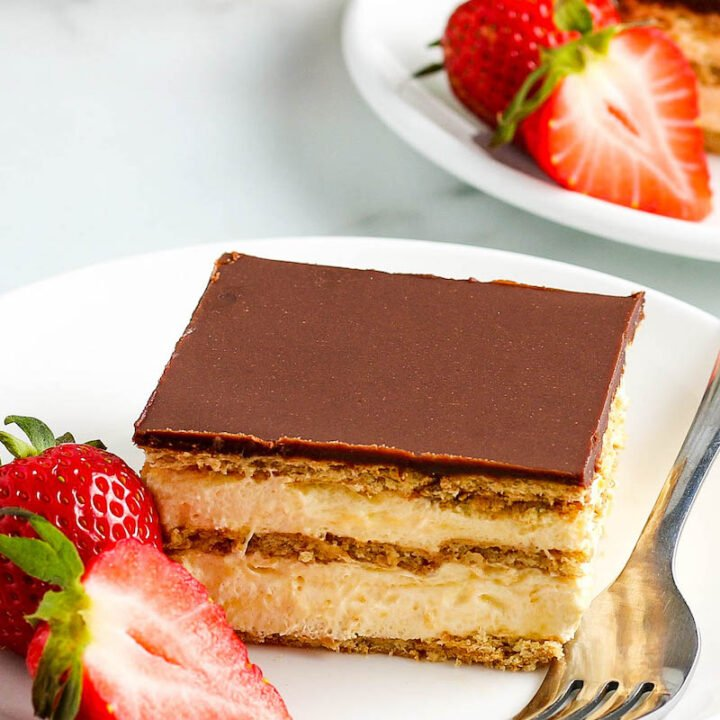 A Slice of No Bake Chocolate Eclair Cake with Strawberries on a Plate