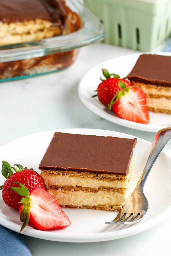 A Piece of The Best Eclair Cake on a Plate