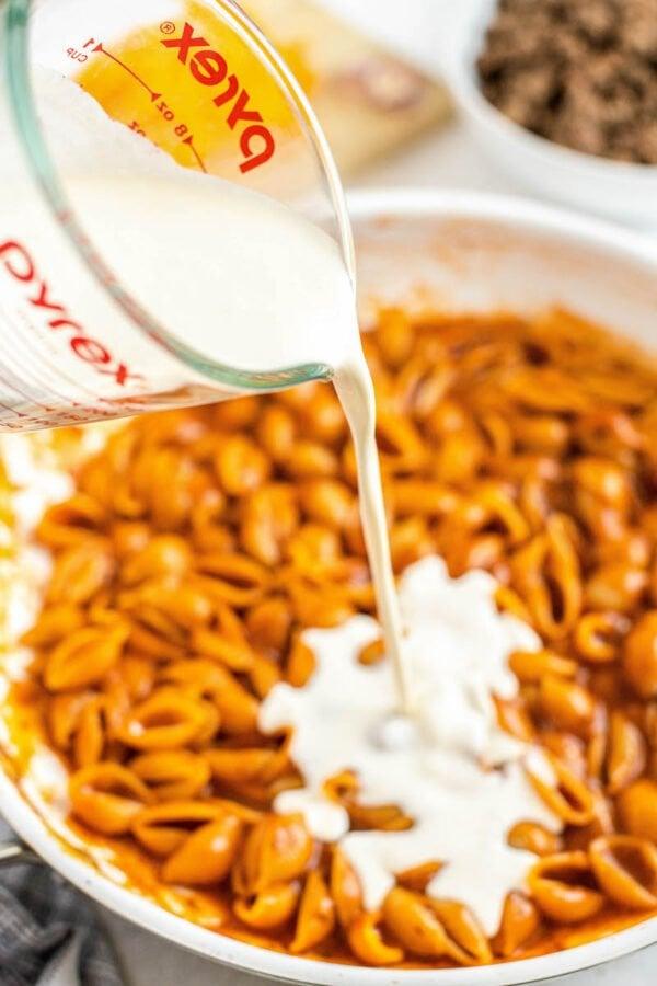 Pouring Cream into Pasta
