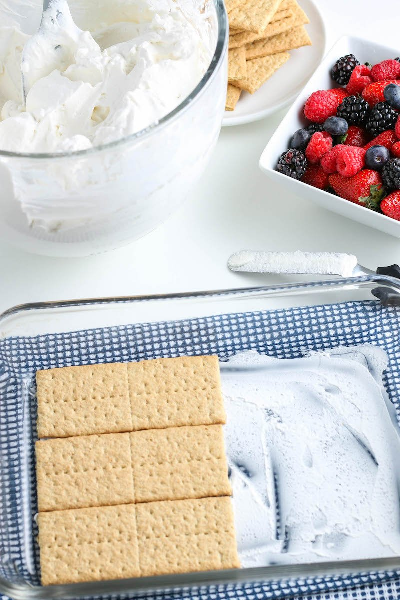 Pan with a thin layer of whipped cream and half a layer of graham crackers on top.