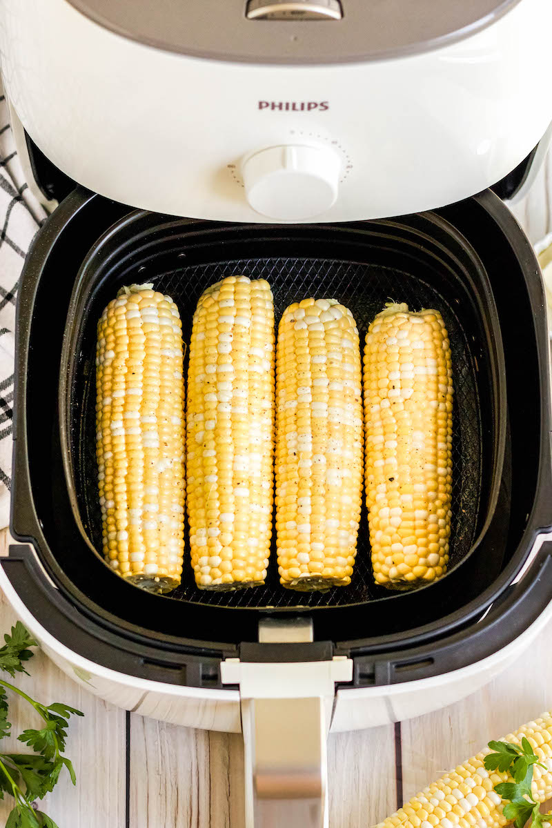 4 corn cobs in a row in the air fryer.