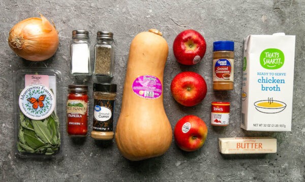 Ingredients for butternut soup on a large countertop.