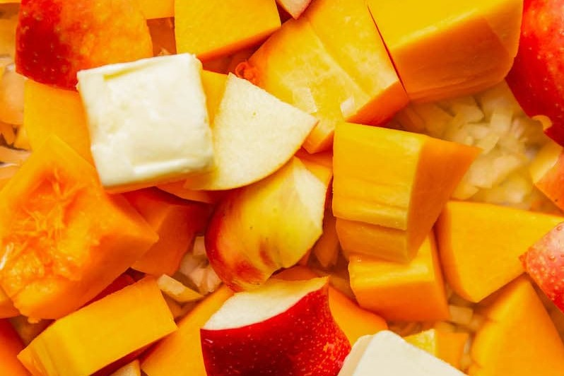 Close-up of cubed butternut squash and apples with butter