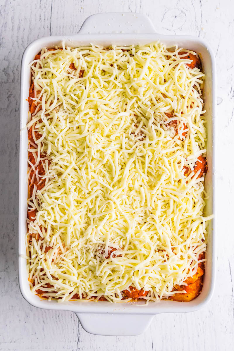 Meatball sub casserole with shredded mozzarella on top.