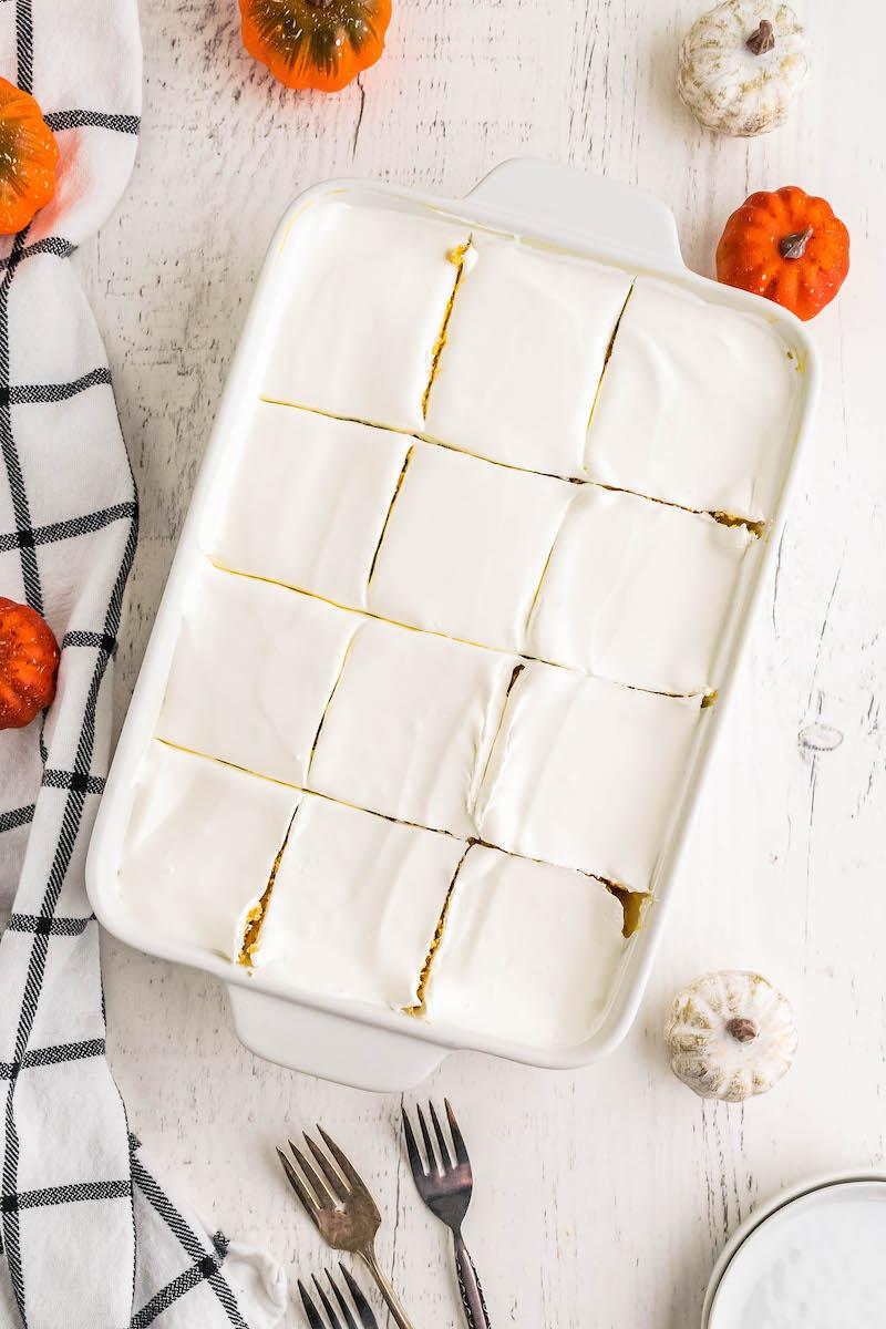 Pan of pumpkin ice box cake sliced into 12 squares.