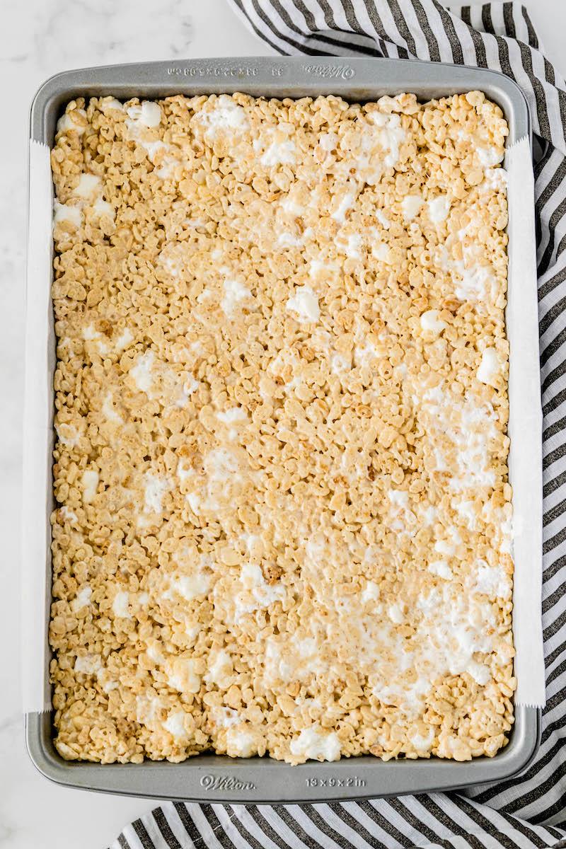 Pan of uncut rice krispie treats.