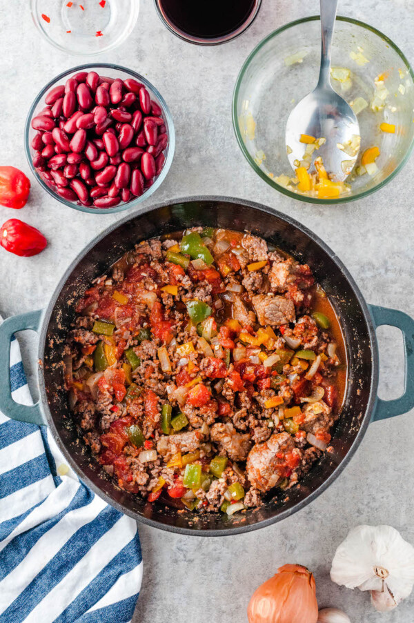 Pot full of vegetables and beef for chunky chili.