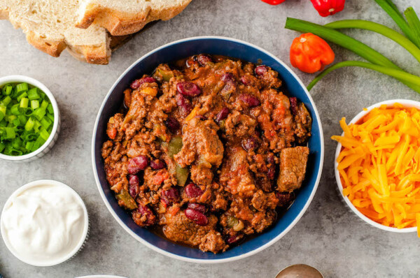 Bowl of chunky chili without toppings.
