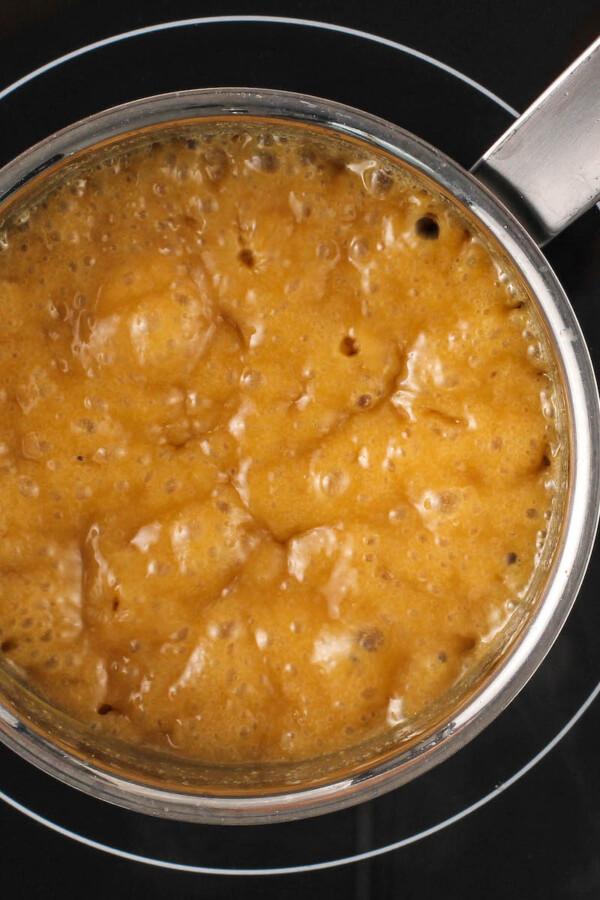 Caramel Sauce bubbling in a sauce pan.