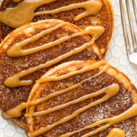 Pinterest collage image of churro pancakes on a white plate with wording.