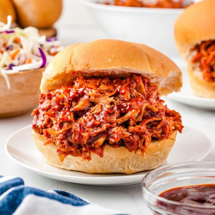 Oven pulled chicken on sandwich buns.