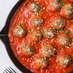 Meatballs and tomato sauce in a pan.