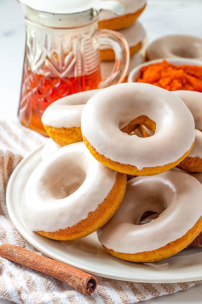 Plate of maple glazed pumpkin donuts.