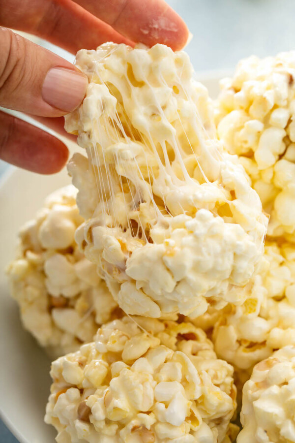 Popcorn being pulled apart to show the marshmallow inside.