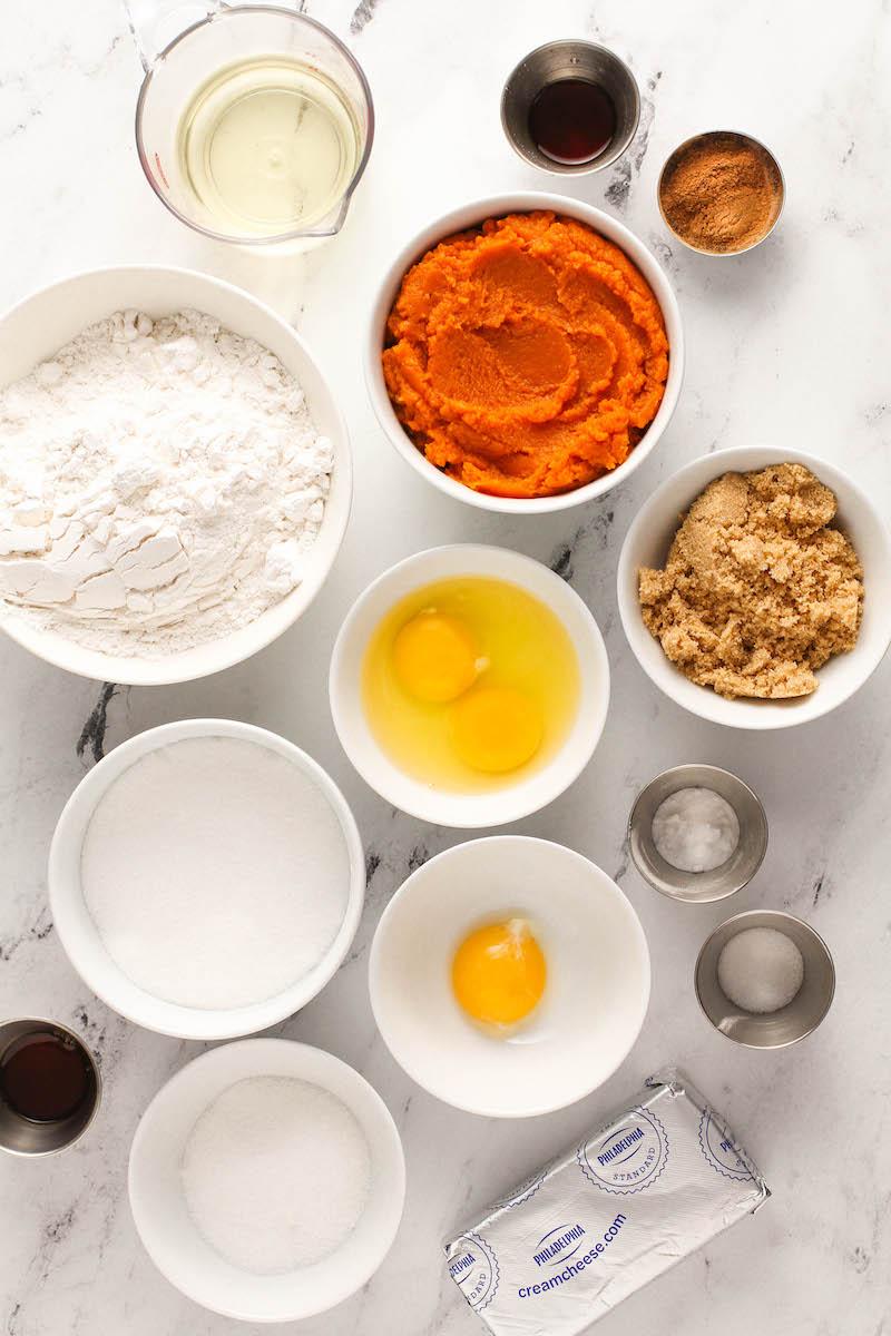 Bowls of pumpkin cream cheese bread ingredients.