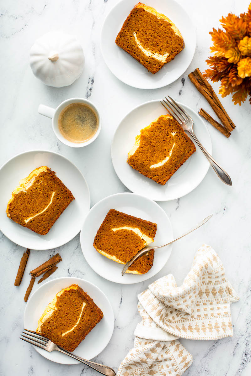 Pumpkin cream cheese bread slices on plates.