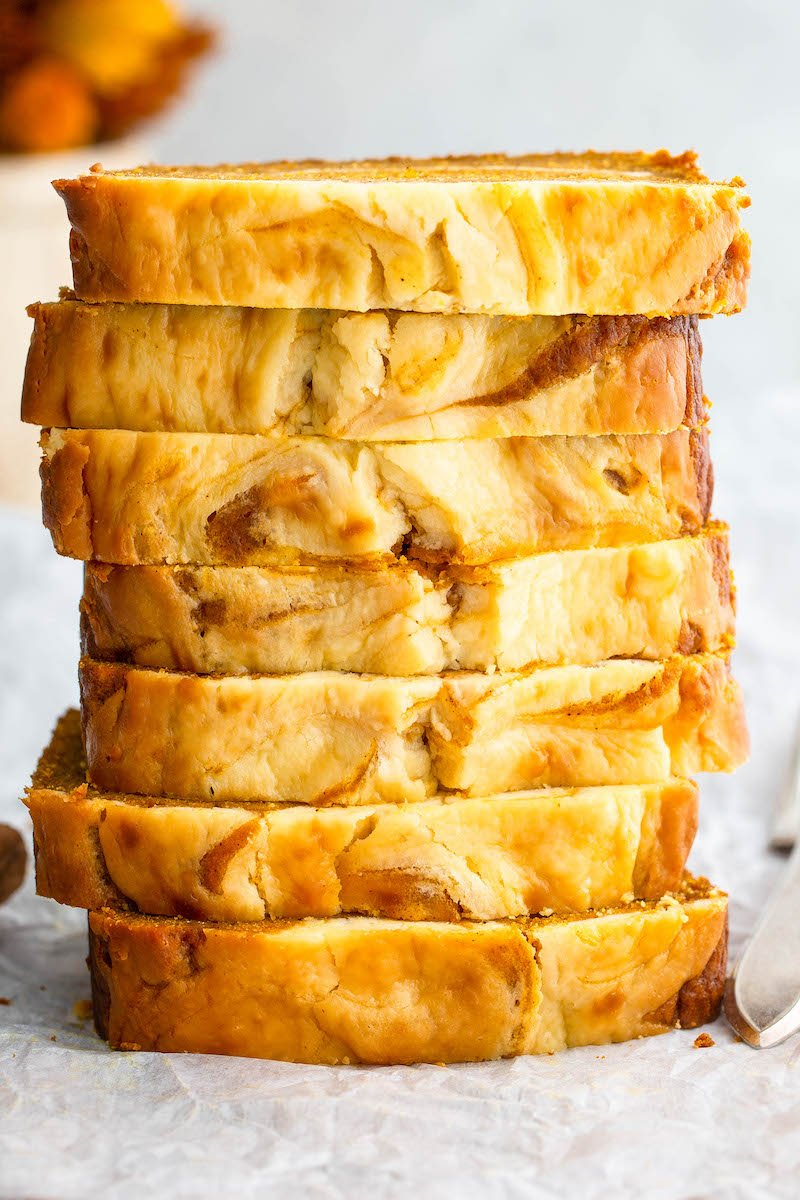 Stack of pumpkin cream cheese bread slices.