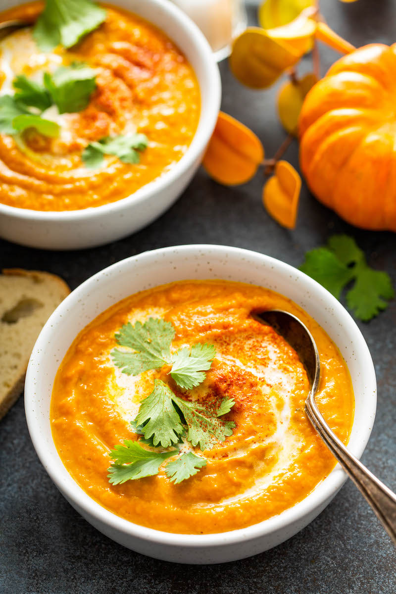 Two bowls of pumpkin soup.