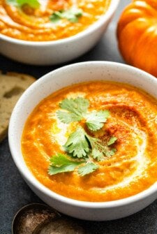 Bowl of pumpkin soup with chopped cilantro.