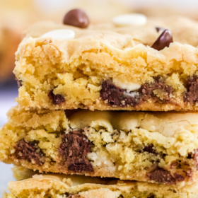 Up close image of chocolate chip cookie bars sliced and stacked on top of each other.