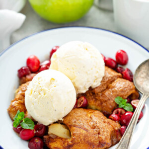 Apple cranberry dumplings with ice cream.