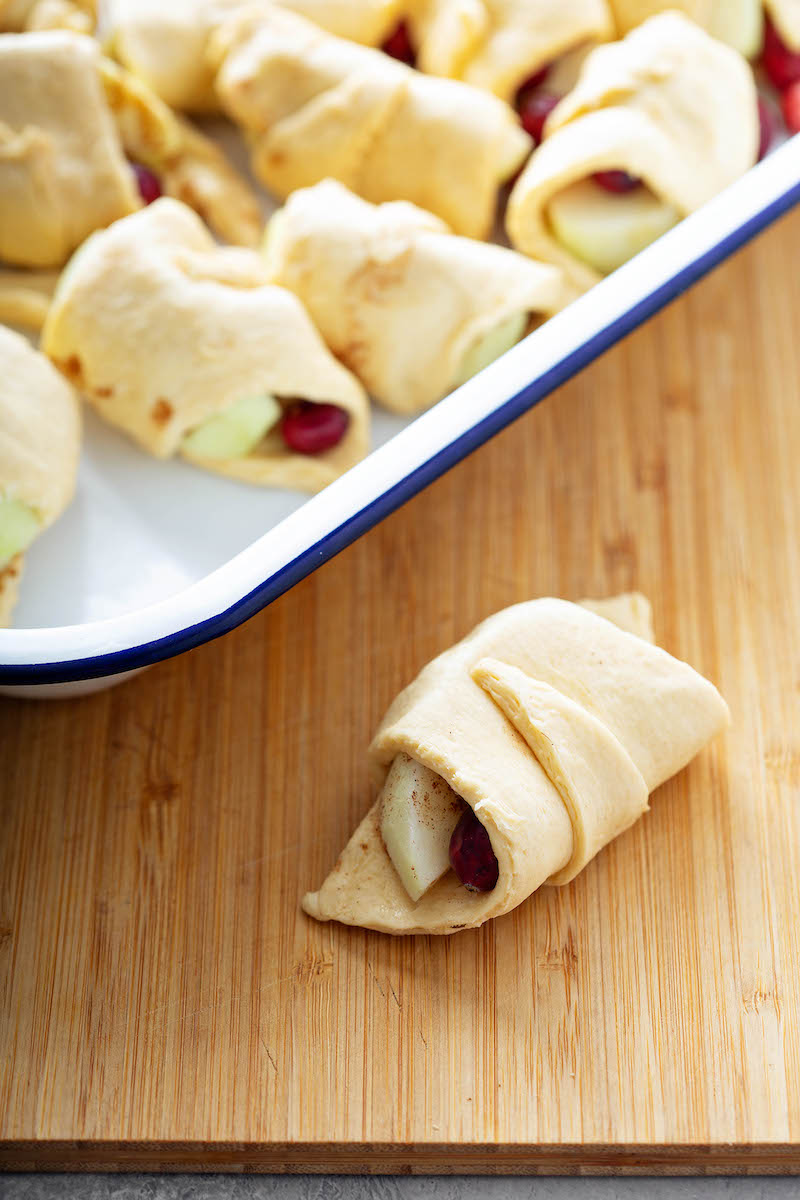 Rolled crescent roll dough with cranberries.