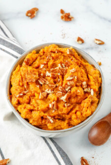 Maple mashed sweet potatoes with chopped pecans.