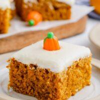 A pumpkin bar is on a plate with a candy pumpkin on top
