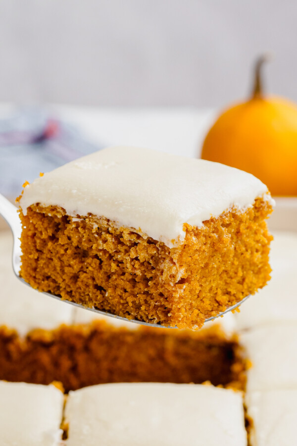 A pumpkin bar is held up with a utensil