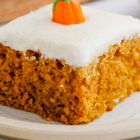 Pinterest image of pumpkin bars with a candy pumpkin on top with wording on the bottom.