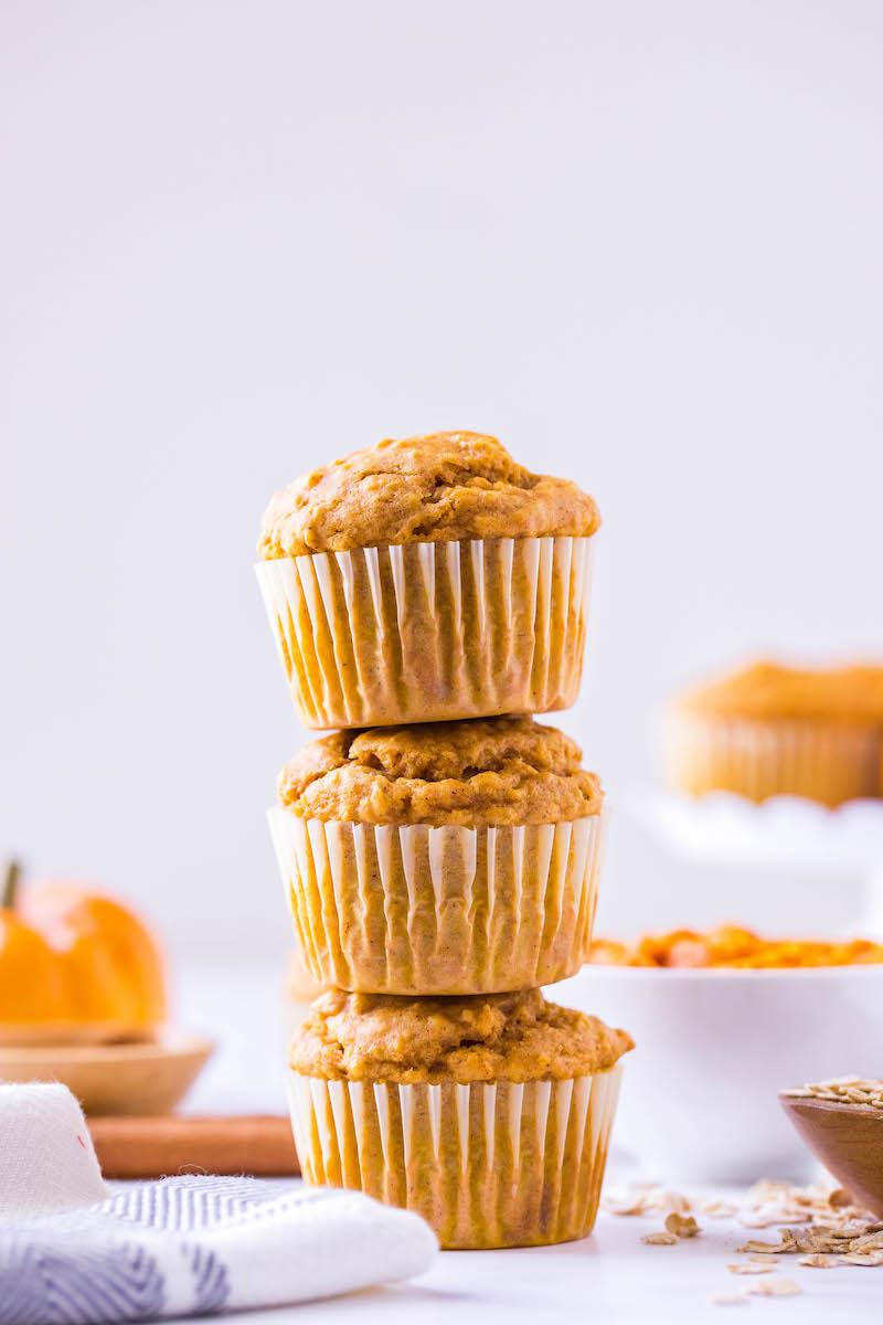 Stack of 3 pumpkin oatmeal muffins.