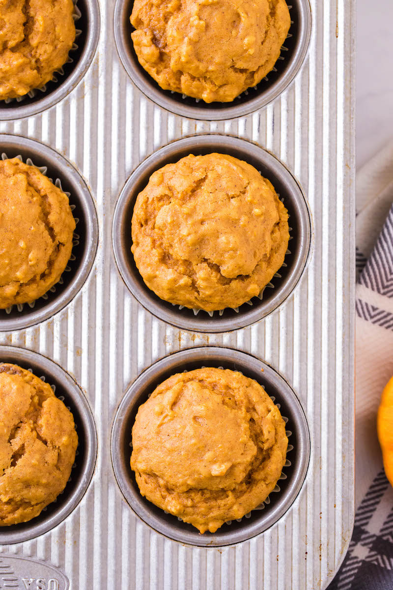 Baked pumpkin muffins in a pan.