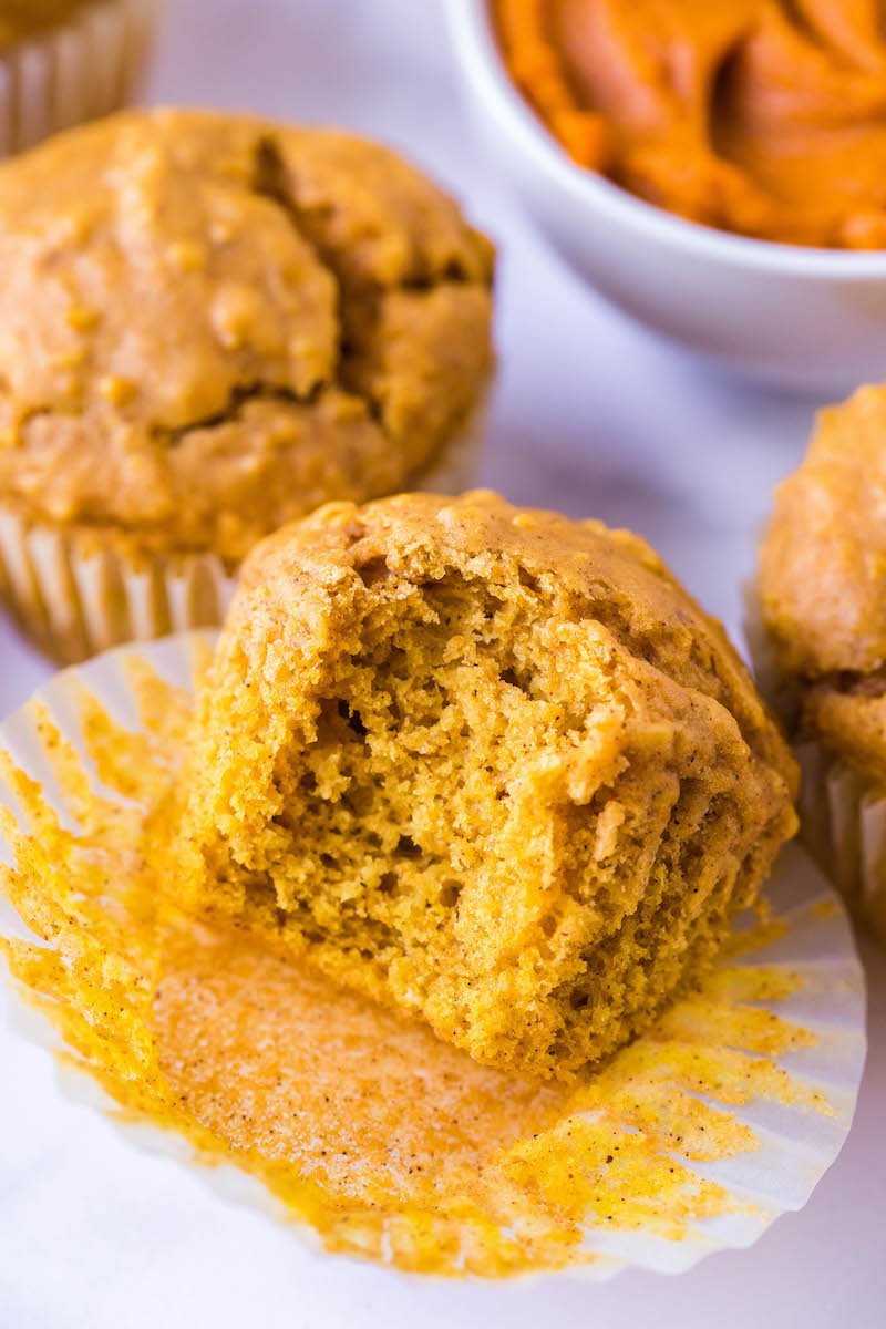 Oatmeal pumpkin muffin with a bite taken out of it.