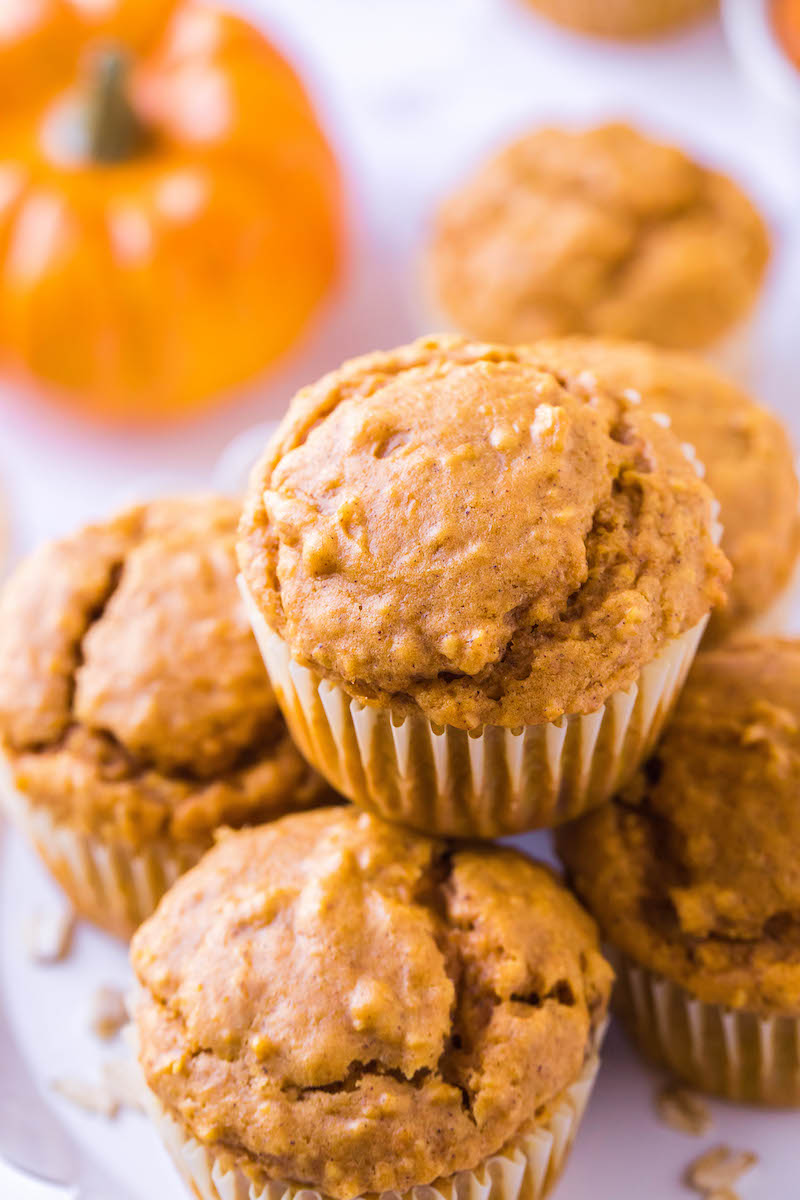 Plate of pumpkin muffins in wrappers.