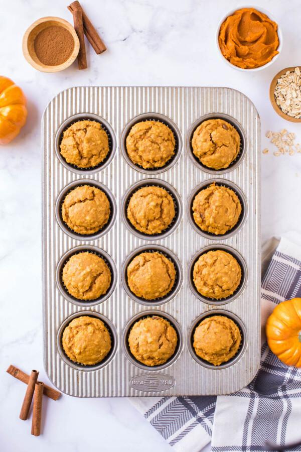 Baked pumpkin oatmeal muffins in a muffin pan.
