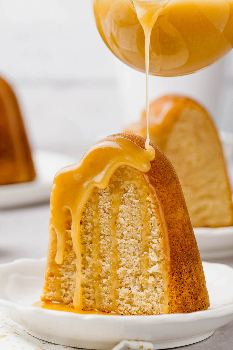 Rumchata sauce poured on a slice of cake.